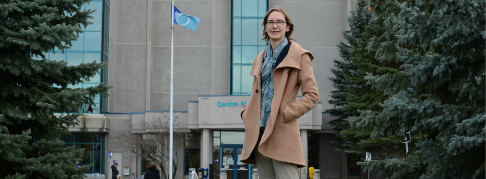 Woman standing in front of Ottawa Public Health