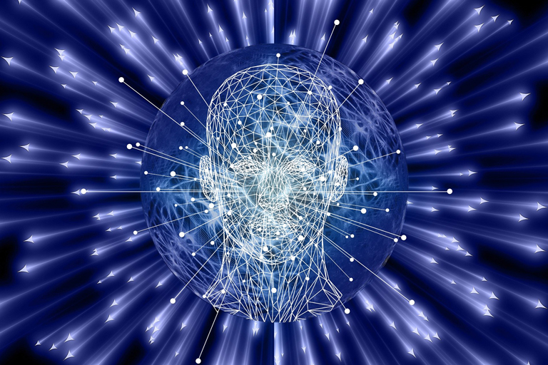 Graphic of the human head surrounded by laser beams