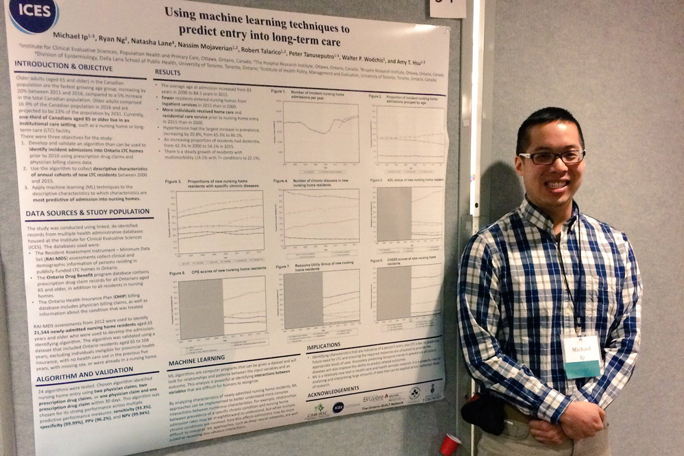Michael Ip standing in front of his research poster