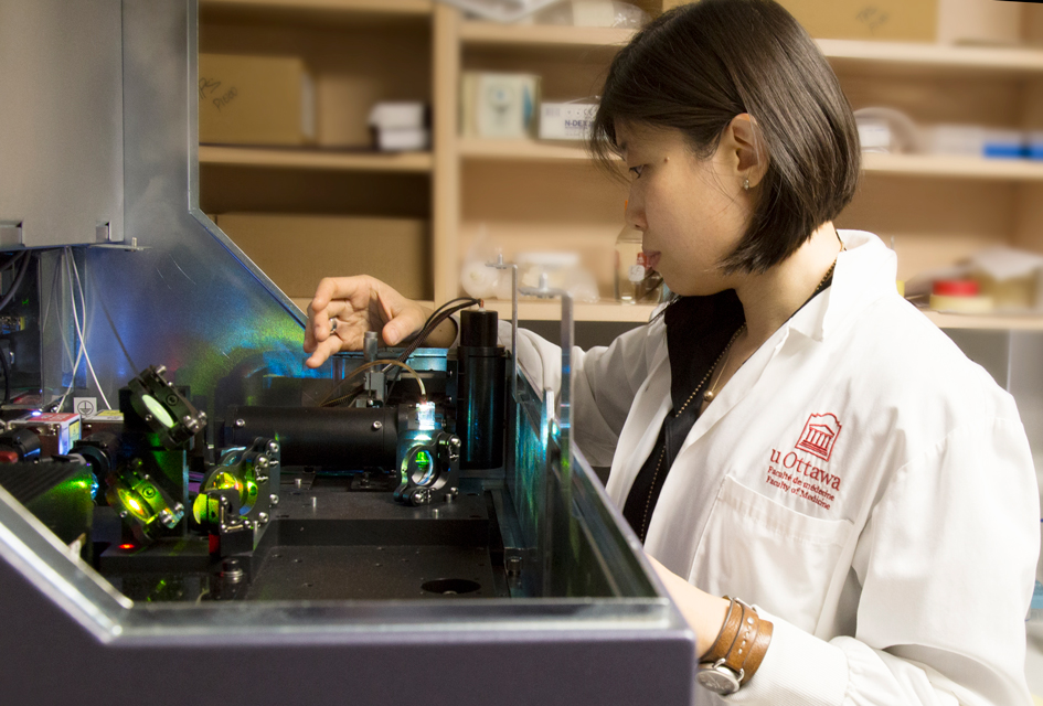 Vera Tang working on the flow cytometer in the lab.