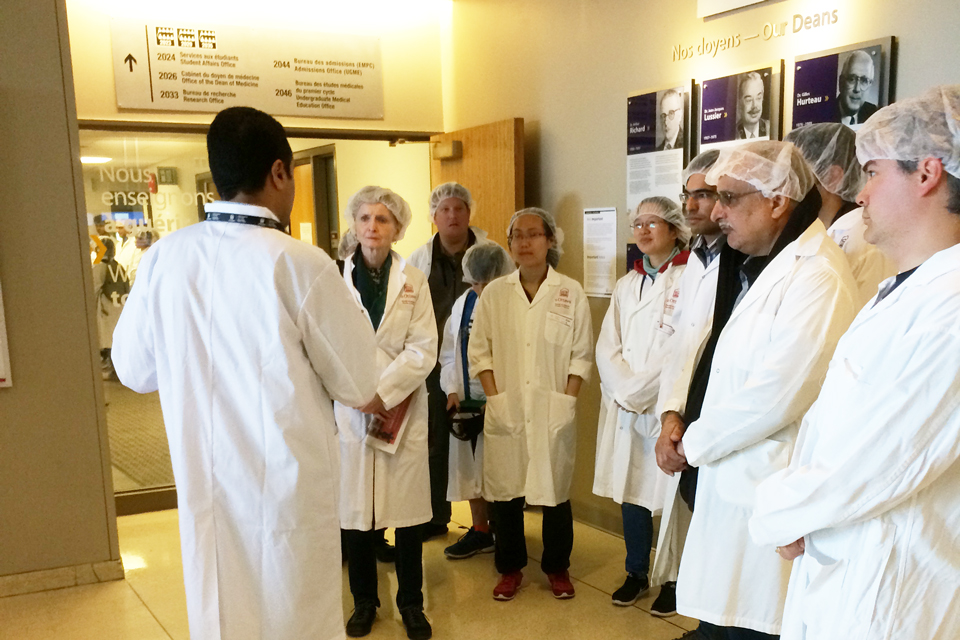 A group of guests prepares to embark on a lab tour.