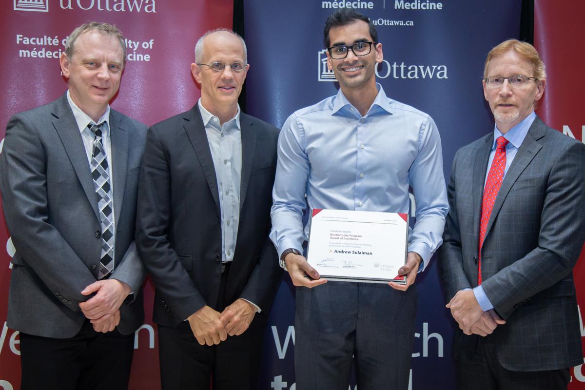 Photo de Dr Alain Stintzi, Dr John Baenziger, Andrew Sulaiman et Dr Bernard Jasmin.