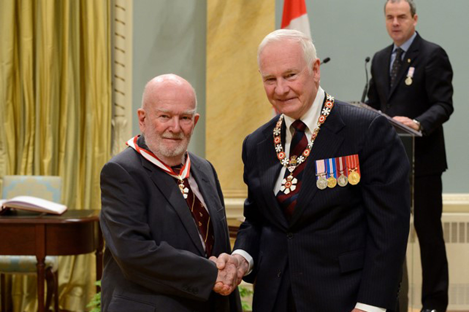 Dr. John Last being presented the honour of Officer of the Order of Canada by His Excellency the Right Honourable David Johnston.