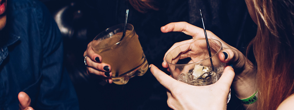 women holding glasses of alcohol