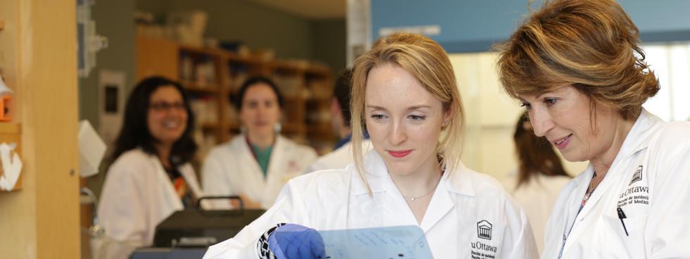 Mona Nemer in a uOttawa lab alongside PhD candidate Jamie Whitcomb. Jamie Whitcomb.