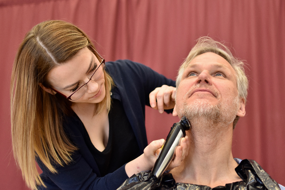 Aesculapian Society VP philanthropy Emma Grigor gives her research supervisor Dr. Andrew Seely a trim.
