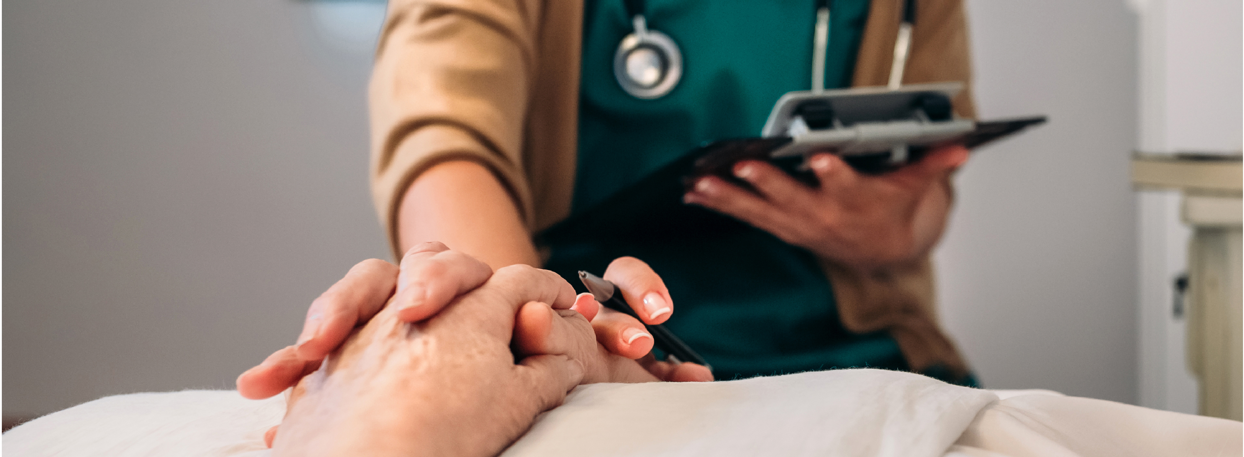 abstract photo of a nurse and patient holding hands