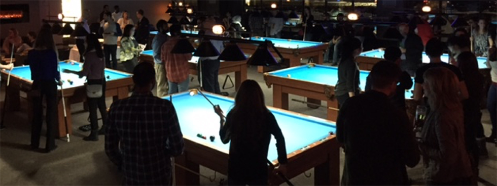 Dark pool hall with several pool tables