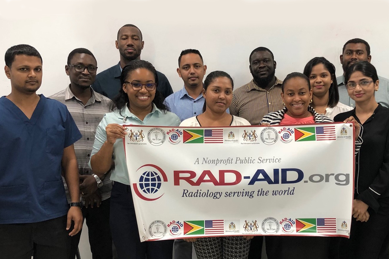 Nine radiology residents from Guyana standing in a group