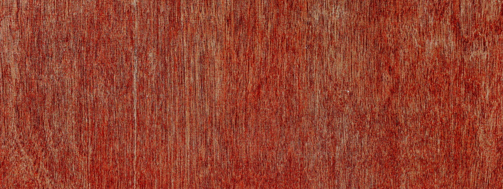 Fond rouge uni texturé.