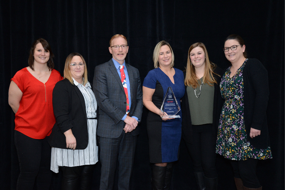 Dr. Jasmin, Dean of the Faculty of Medicine, with members of the Research and Innovation office, winner of the 2019 Team Service Excellence award.