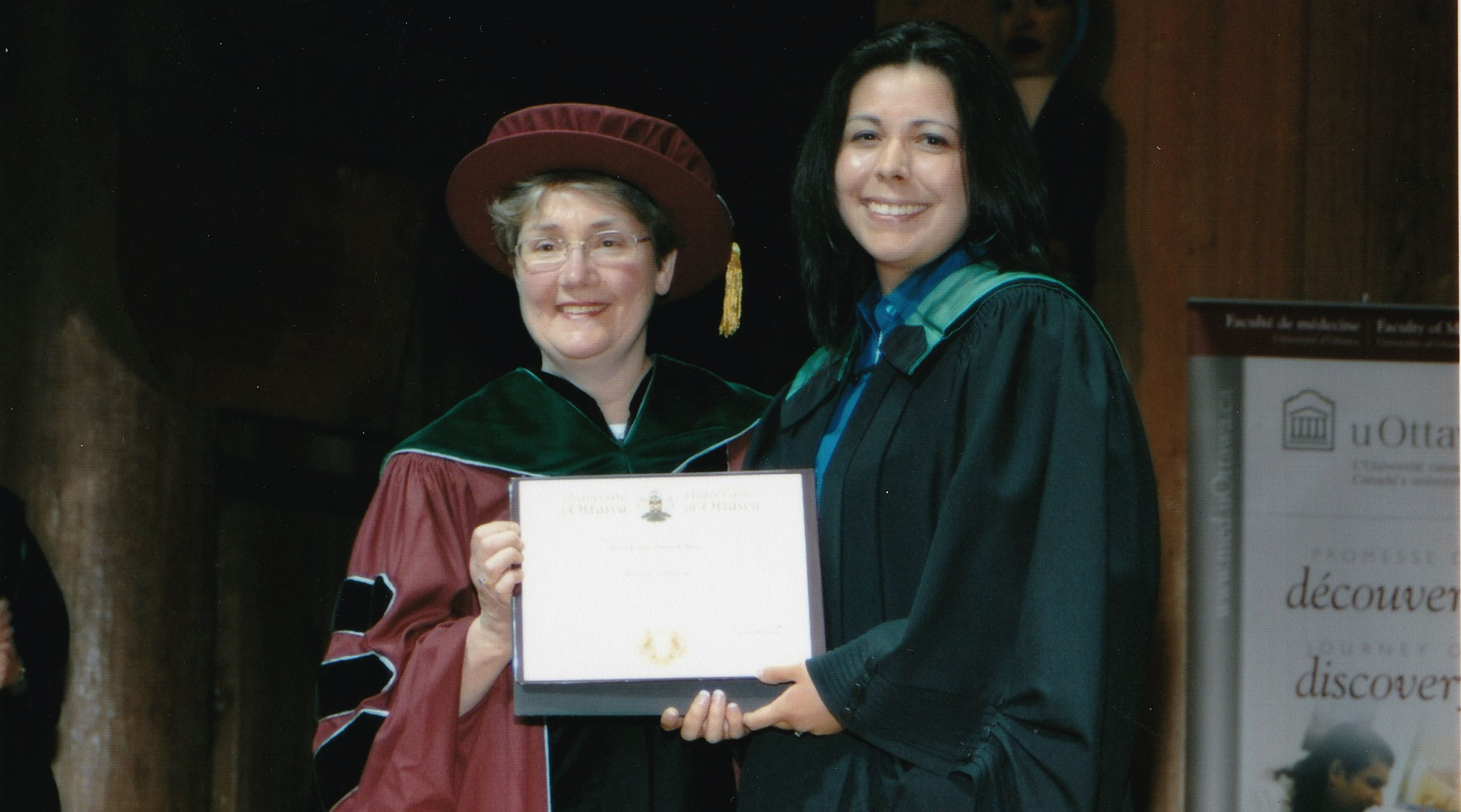 Photo of Kona Williams receiving her MD diploma from uOttawa professor Dr. Mary Senterman.