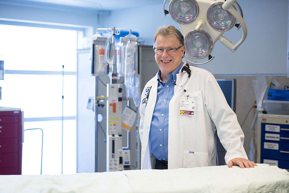 Dr. Stiell in a hospital room.