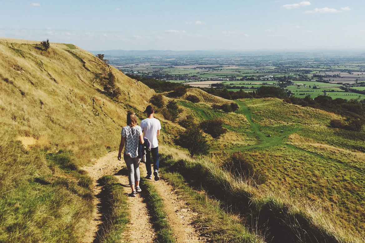 Two people enjoying a walk in the countryside.