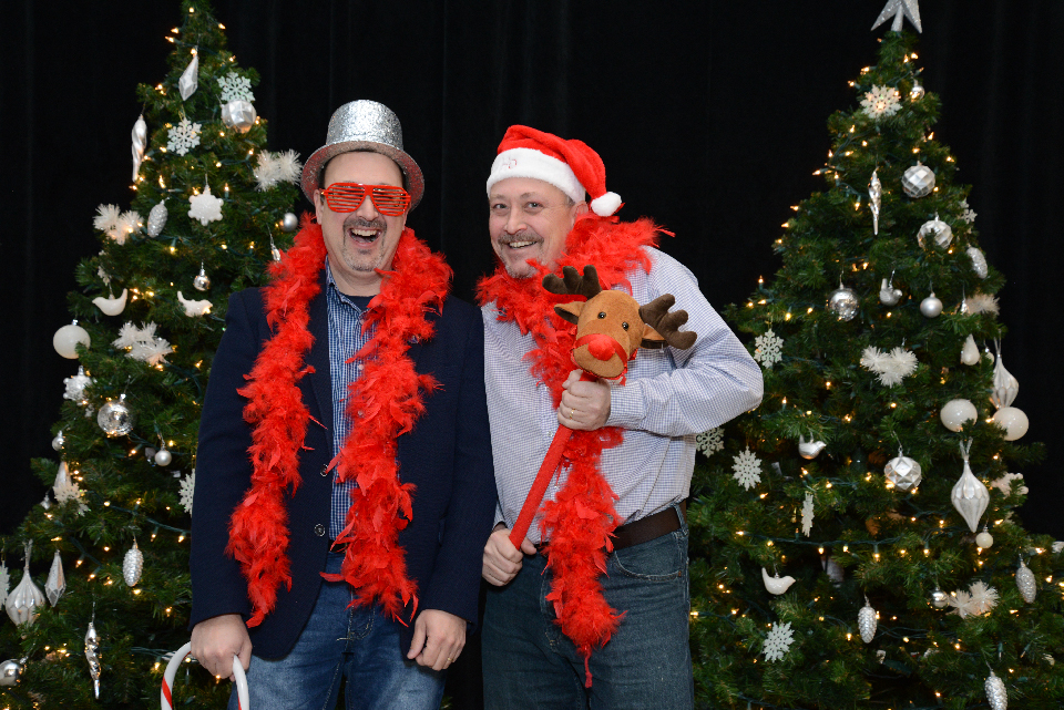 Two Faculty of Medicine employees having fun at the holiday photo booth.