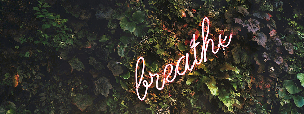 "neon sign that says ""breath"""