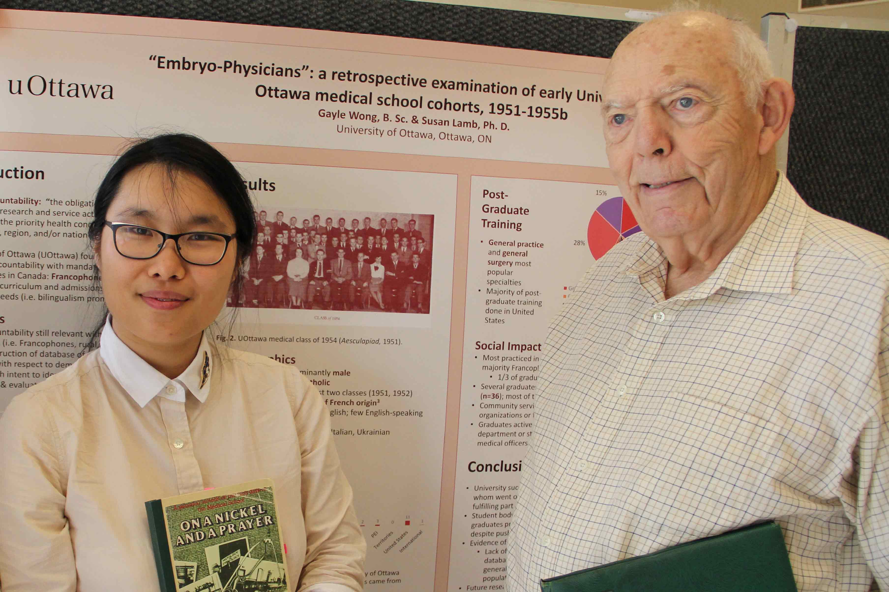Photo of Gayle Wong and Dr. George Taylor standing in front of her poster.