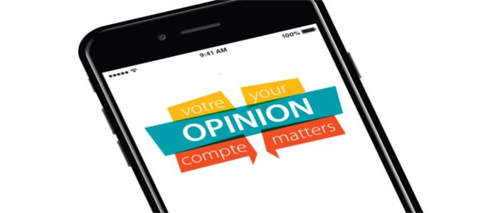 Cellulaire dont l'écran affiche « Votre opinion compte »