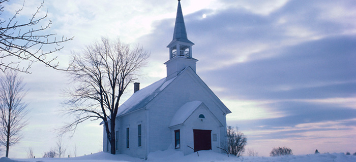 Rural church in winter landscape