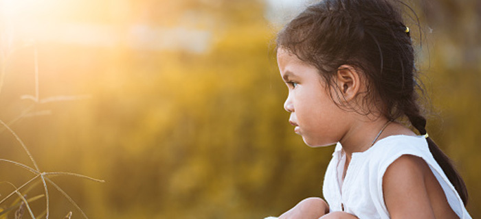 A female child is looking at the field