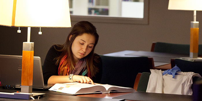Undergraduate Student studying in a library